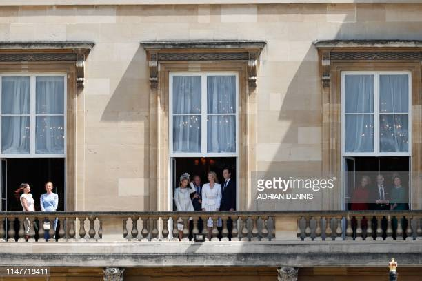 Guests including Ivanka Trump and her husband Senior Advisor to the President of the United States Jared Kushner watch from a balcony as the US...