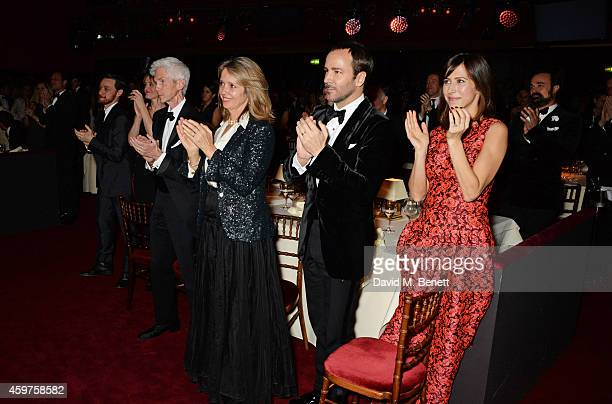 Guests including James McAvoy AnneMarie Duff Richard Buckley Sabrina Guinness Tom Ford Sophie Hunter and Evgeny Lebedev applaud Sir Tom Stoppard as...