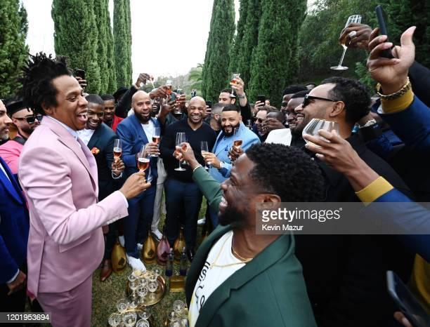 Guests including JayZ Christian Combs Kareem Burke Juan PerezSean Combs Joey Bada$$ Leonard Fournette Meek Mill and Dez Bryant toast during 2020 Roc...
