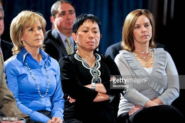 Guests including Kathy Battaglia left Kultida Woods mother of golfer Tiger Woods center and Amy Reynolds right listen as Tiger Woods speaks during a...
