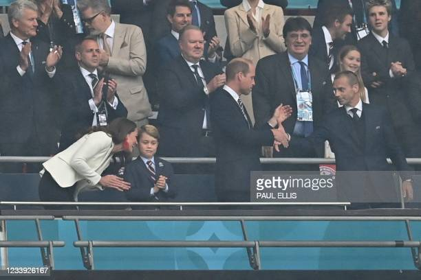 Guests, including Prince William, Duke of Cambridge, Prince George of Cambridge, and Catherine, Duchess of Cambridge, UEFA President Aleksander...