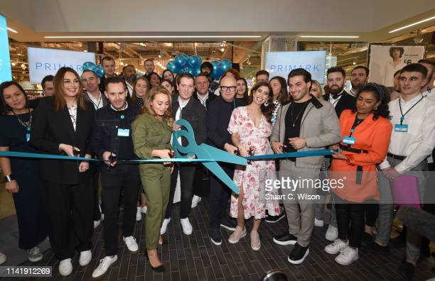 Guests including Stacey Solomon Alice Liveing Kem Cetinay Alessandra Steinherr and Paul Marchant cut the ribbon to open the world largest Primark...