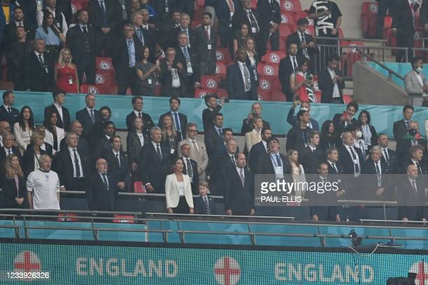 Guests, including UK Prime Minister Boris Johnson and his spouse Carrie, Prince William, Duke of Cambridge, Prince George of Cambridge, and...