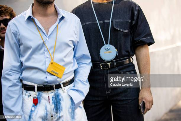 Guests Jacquemus mini purses details are seen during the Milan Men's Fashion Week Spring/Summer 2020 on June 16 2019 in Milan Italy
