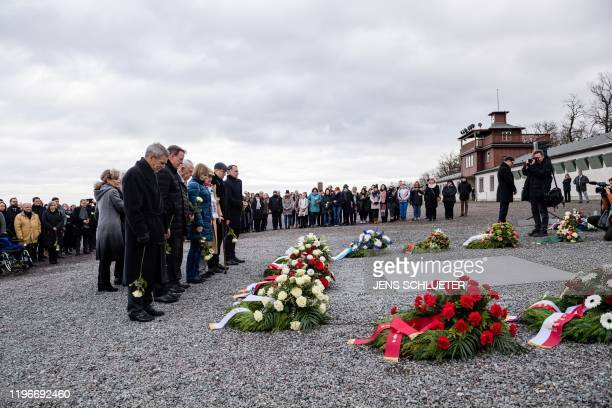 Guests lay flowers and pay their respects during a ceremony at the memorial site of the former Nazi concentration camp Buchenwald near Weimar eastern...