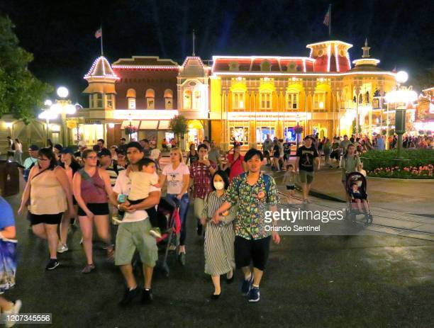 Guests leave the Magic Kingdom at Walt Disney World in the final minutes before the park closed Sunday night March 15 in Lake Buena Vista Fla Walt...
