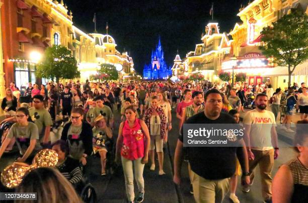 Guests leave the Magic Kingdom at Walt Disney World in the final minutes before the park closed, Sunday night, March 15 in Lake Buena Vista, Fla....