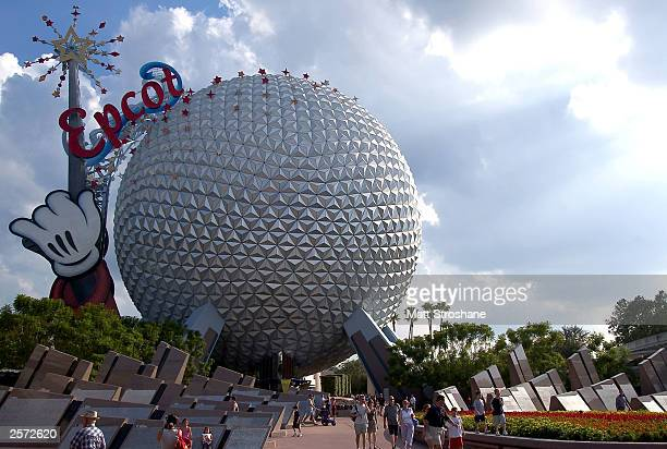 Guests leave Walt Disney World's Epcot October 8 2003 near Orlando Florida