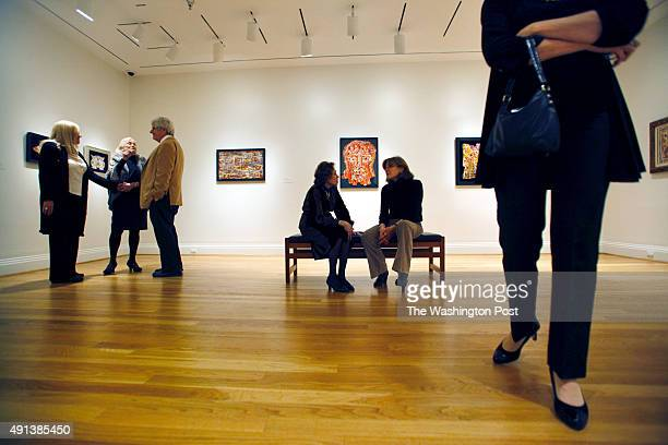 Guests linger in the room dedicated to the work of Alfonso Ossorio American artist and patron at the Phillips Collection exhibition preview and...