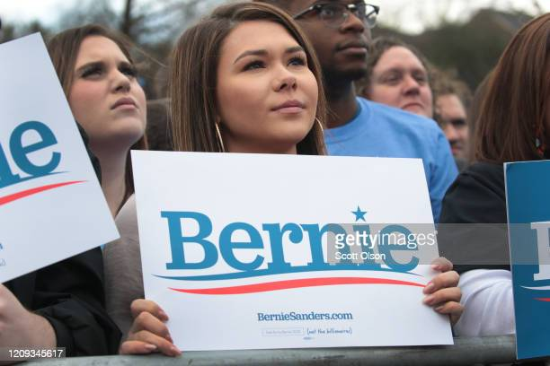Guests listen as Democratic presidential candidate Sen Bernie Sanders speaks during a campaign rally at Finlay Park on February 28 2020 in Columbia...