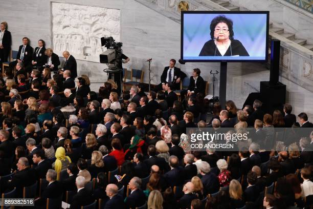 Guests listen as Hiroshima nuclear bombing survivor Setsuko Thurlow who received the 2017 Nobel Peace Prize on behalf of the International Campaign...