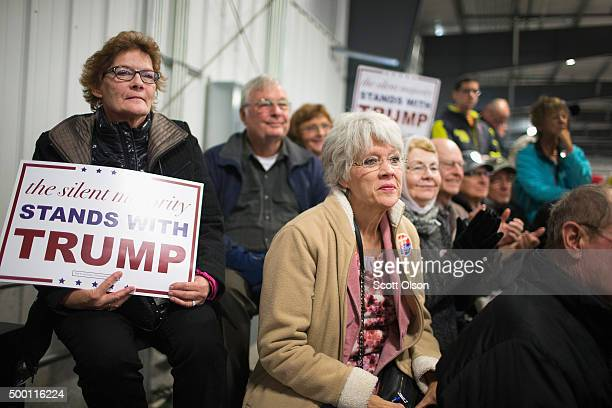 Guests listen as Republican presidential candidate Donald Trump speaks at a campaign event at Mississippi Valley Fairgrounds on December 5 2015 in...