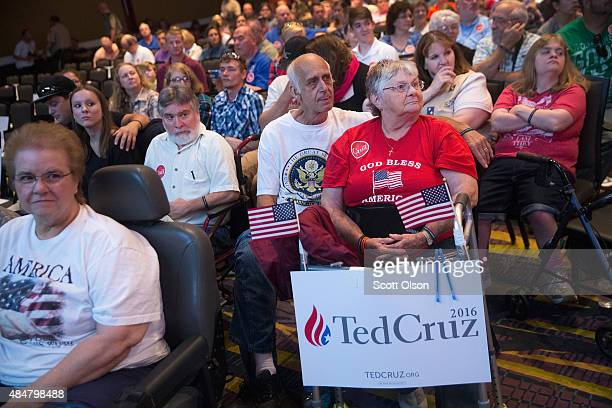 Guests listen as Republican presidential candidate Sen Ted Cruz speaks at his Religious Liberty Rally on August 21 2015 in Des Moines Iowa Earlier in...