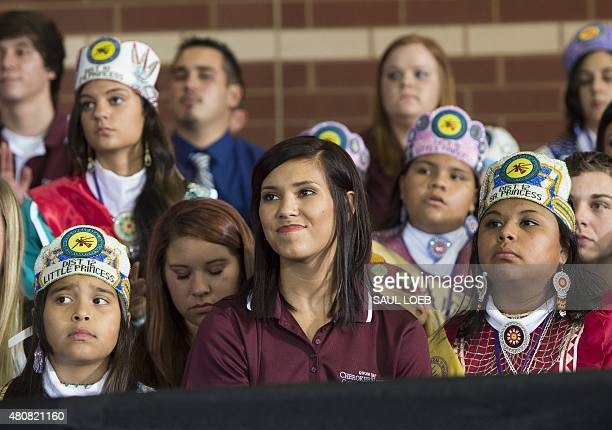 Guests listen as US President Barack Obama speaks about economic opportunities at Durant High School in Durant Oklahoma in the Choctaw Nation July 15...