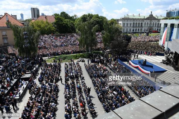 Guests listen as US President Donald Trump gives a speech on Krasinski Square during the Three Seas Initiative Summit in Warsaw Poland July 6 2017 /...