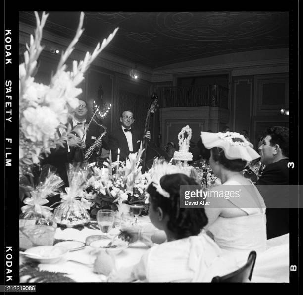 Guests listen to a wedding band perform at a wedding reception in Brooklyn Heights in March 1958 in New York City New York