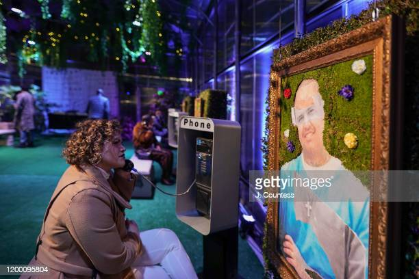 Guests listen to stories told by formerly incarcerated people and their relatives at one-of-a-kind phone booth installations featuring stories told...
