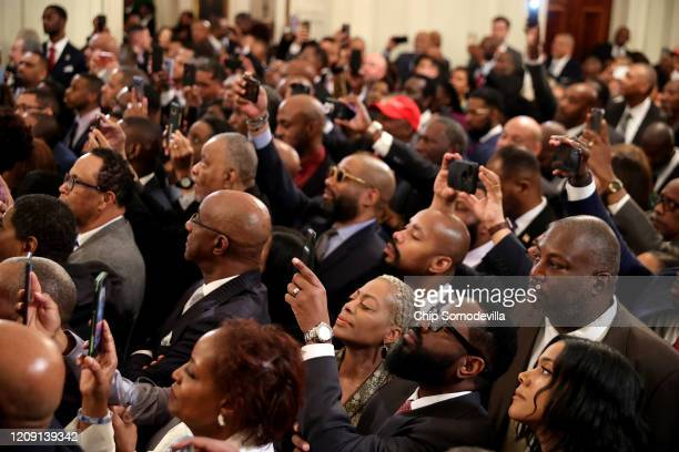 Guests listen to US President Donald Trump during a Black History Month reception in the East Room of the White House February 27 2020 in Washington...