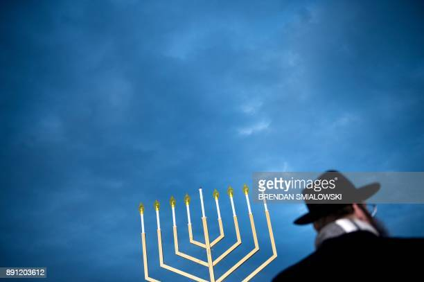TOPSHOT A guests listens during the National Chanukah Menorah lighting on the Ellipse December 12 2017 in Washington DC / AFP PHOTO / Brendan...