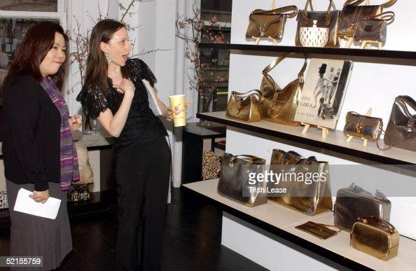 204778432138 Guests look at a display of purses at the Kate Spade press preview... News  Photo