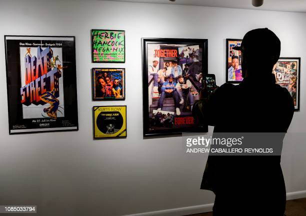 Guests look at memorabilia at the HipHop Museum Pop Up Experience in Washington DC on January 19 2019 The month long celebration of HipHop began with...