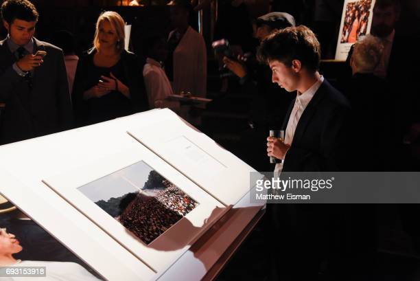 Guests look at photographic prints ondisplay during the 2017 Gordon Parks Foundation Awards Gala at Cipriani 42nd Street on June 6 2017 in New York...