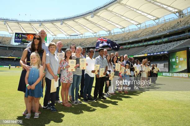 Guests look on during an Australian citizenship ceremony before game one of the One Day International series between Australia and South Africa at...