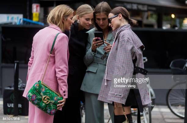 Guests looking at a phone outside Rodebjer on August 30 2017 in Stockholm Sweden