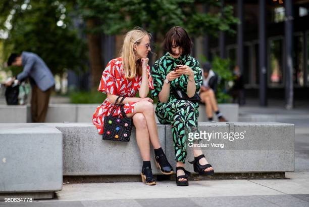 Guests looking on a smartphone seen outside Issey Miyake on day three of Paris Fashion Week Menswear SS19 on June 21 2018 in Paris France