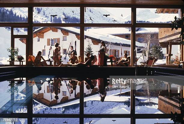 Guests lounging by the indoor swimming pool of the Gasthof Post in Lech Austria February 1979