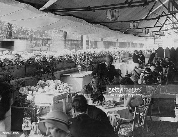 Guests lunching on a terrace restaurant at The Dorchester hotel London circa 1930