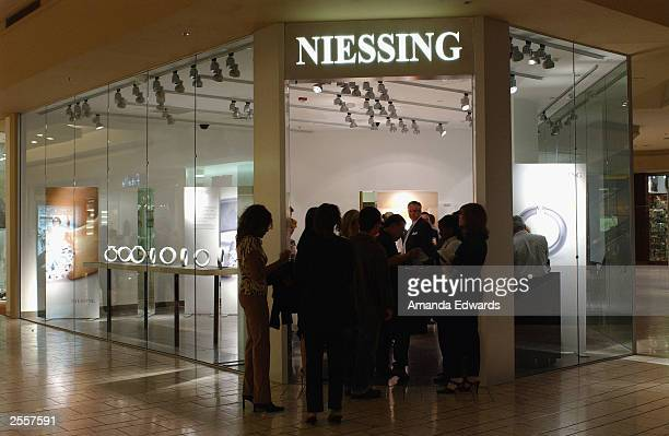 Guests mingle at the Knockout Preview Party hosted by Jackie Kallen and Niessing Jewelry in the new Niessing shop at the Beverly Center on October 2...