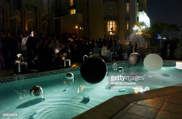 Guests mingle by the pool at the Christian Dior 'D'Trick' Launch Party on June 3 2004 at Fenix Restaurant at the Argyle Hotel in Los Angeles...