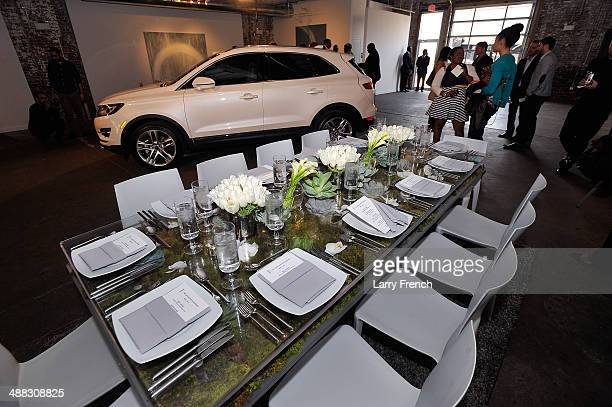Guests mingle during a design discussion and luncheon featuring the all new Lincoln MKC at Long View Gallery on May 5 2014 in Washington DC