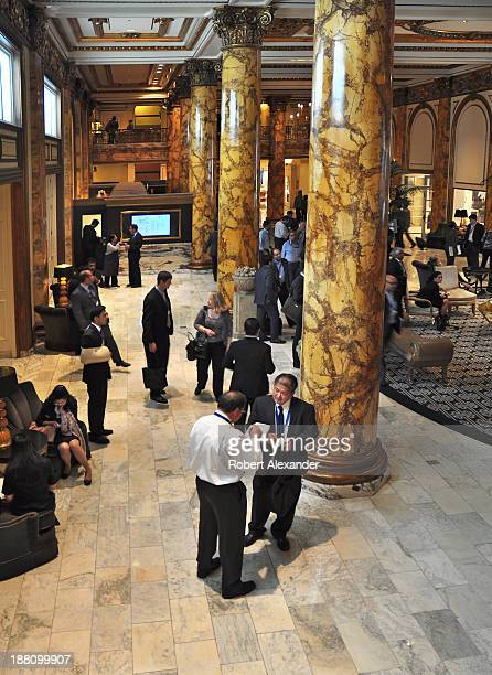Guests mingle in the lobby of the historic Fairmont Hotel in San Francisco's upscale Nob Hill district The luxury hotel which opened in 1907 is owned...