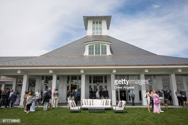Guests mingle on the back patio following a ribbon cutting event for a new clubhouse at Trump Golf Links at Ferry Point, June 11, 2018 in The Bronx...