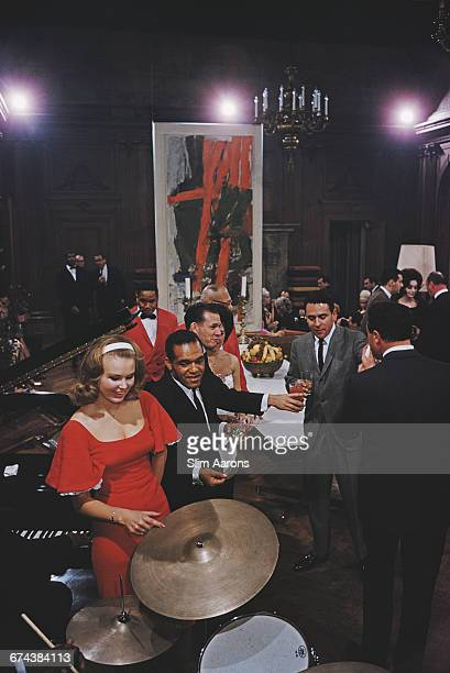 Guests of American publisher Hugh Hefner enjoying themselves at a party being held at the Playboy Mansion Chicago 1961