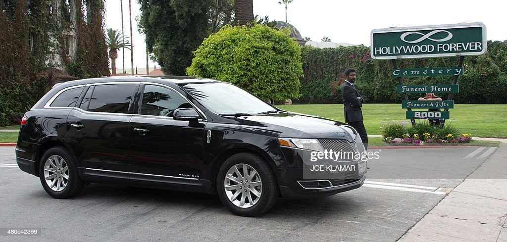 Guests of Mick Jagger and close family members of his girlfriend LWren Scott depart Hollywood Forever Cemetery following her funeral in Hollywood, California on March 25, 2014. The model-turned-fashion designer was found hanged in her luxury New York apartment last week. She was 49. The cemetery was closed for the roughly one-hour service, held amid tight security.
