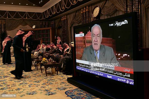 Guests of Saudi King Abdullah have tea and watch the News before a dinner the King hosted for President Bush at Al Janadriyah Farm in Saudi Arabia...