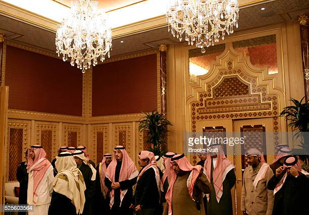 Guests of Saudi King Abdullah mingle before a dinner the King hosted for President Bush at Al Janadriyah Farm in Saudi Arabia The farm is the...