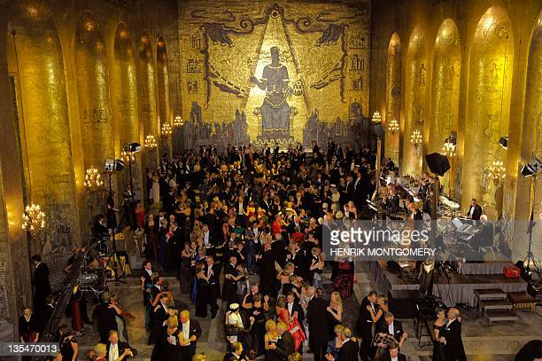 Guests of the Nobel banquet dance at the golden hall in the Stockholm City Hall following the Nobel award ceremony on December 10 2011 AFP PHOTO/...
