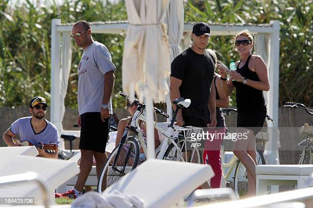 Guests of US actors Justin Timberlake and fiance Jessica Biel stand by the pool of the Bagno Egnazia resort in Fasano in the southern Italian region...