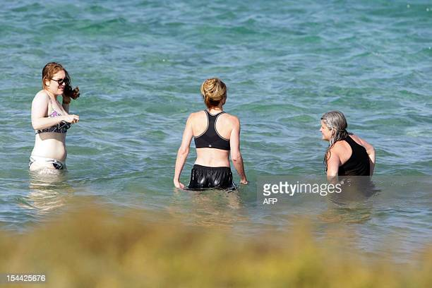Guests of US actors Justin Timberlake and fiance Jessica Biel take a bath in the sea at the Bagno Egnazia resort in Fasano in the southern Italian...