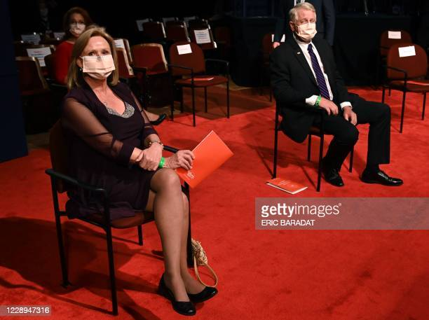 Guests of US Vice President Mike Pence Mike Pence, Marsha and Carl Mueller, parents of Kayla Mueller, look on as they wait for the start of the vice...