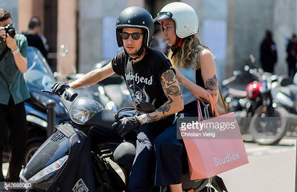 Guests on a motorbike outside Rick Owens during the Paris Fashion Week Menswear Spring/Summer 2017 on June 23 2016 in Paris France
