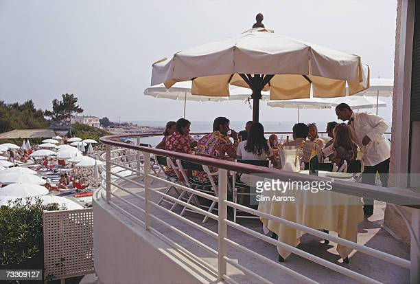 Guests on the terrace at the Hotel du Cap EdenRoc Antibes France August 1969