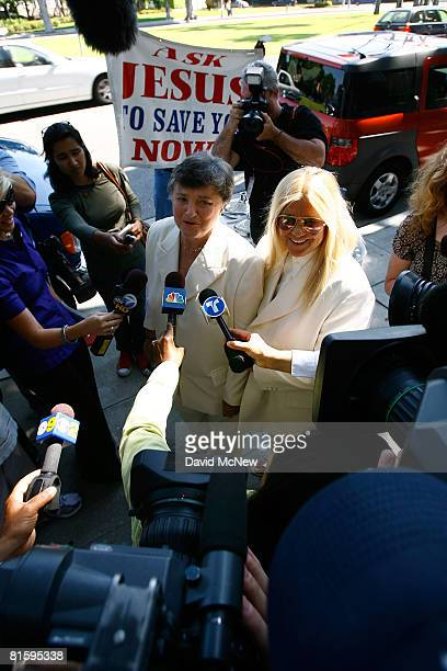 Guests onlookers and protesters surround lesbian couple Robin Tyler and Diane Olson as they talk to the media after they are joined in the first...