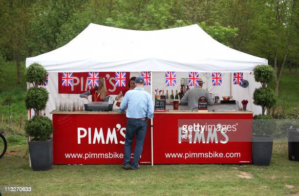 Guests order Pimms to drink at a Tea in the Park event in Kate Middleton's home village of Bucklebury Berkshire on April 29 2011 AFP PHOTO / CHRIS...