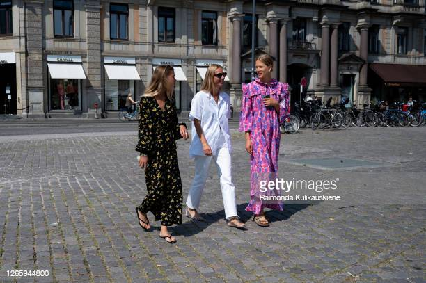 Guests outside Helmstedt wearing black/yellow, white and pink/purple outfit during Copenhagen fashion week SS21 on August 12, 2020 in Copenhagen,...