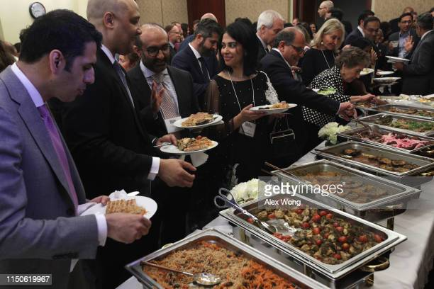 Guests participate in a congressional Iftar event at the US Capitol May 20 2019 in Washington DC Muslims around the world are observing the holy...